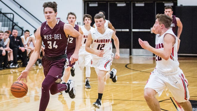 Wes-Del's Sutter Foster sprints up the court in a December game against Wapahani. The Warriors face Alexandria in their season finale on Friday.