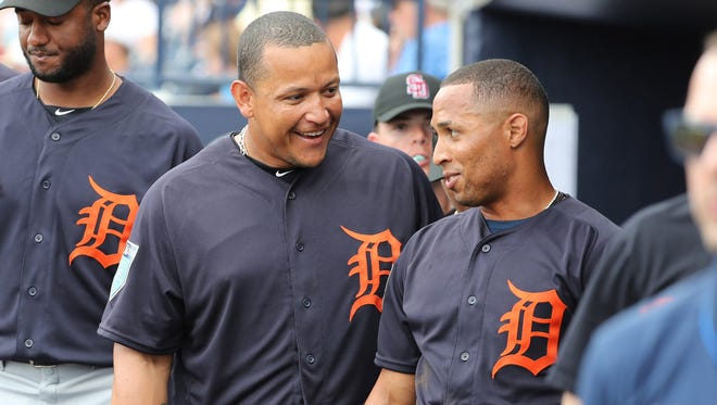 Tigers outfielder Leonys Martin (12) is congratulated by  designated hitter Miguel Cabrera (24) after he scored in the first inning of the Tigers' 3-1 exhibition loss to the Yankees on Friday, Feb. 23, 2018, in Tampa, Fla.