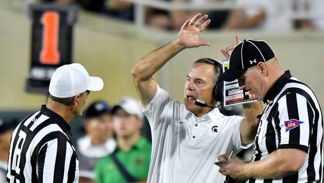 Mark Dantonio argues with officials who ruled an Irish pass complete for a second quarter touchdown.