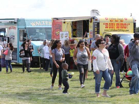 File photo: People line up for food at the various food trucks on the infield, during the Food Truck Mash-Up at Empire City Casino in Yonkers, Sept. 10, 2017.