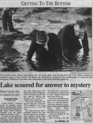 A News-Press clip from November 1999 shows Punta Gorda police officers scouring Preacher's Lake after 4-year-old Pilar Rodriguez went missing.