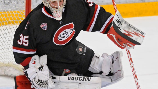 St. Cloud State goaltender Charlie Lindgren concentrates on the puck during the first period of Friday's game at the Herb Brooks National Hockey Center in St. Cloud.