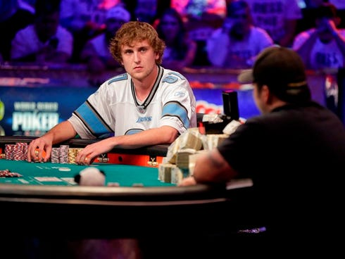 Ryan Riess, left, waits for a play from Jay Farber during the World Series of Poker final table in Las Vegas.