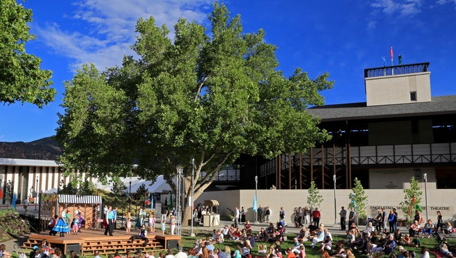 Utah Shakespeare Festival patrons gather Saturday for the Paris Bistro show at the Greenshow Commons at The Beverley Center for the Arts in Cedar City.
