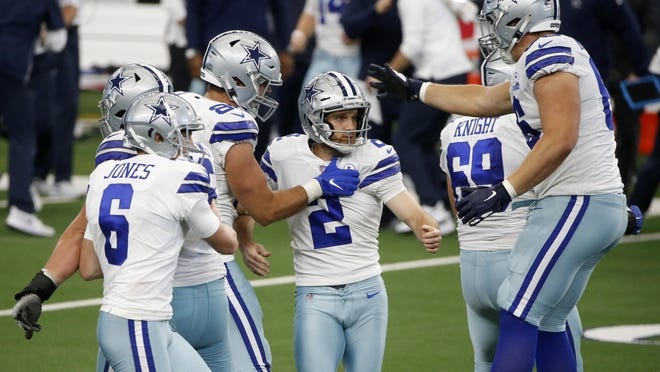 Dallas Cowboys' Chris Jones (6) and others celebrate with kicker Greg Zuerlein (2) after Zuerlein kicked a field goal to help the Cowboys to a 40-39 win against the Atlanta Falcons in an NFL football game in Arlington, Texas, Sunday, Sept. 20, 2020.