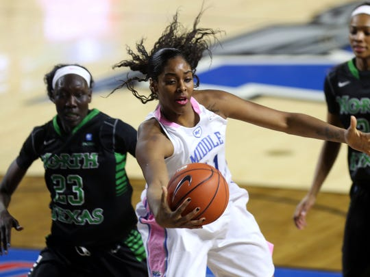 MTSU's Cheyenne Parker pulls in a pass from a teammate in the first half against North Texas Saturday, Feb. 14, 2015 at MTSU. MTSU won 85-59.