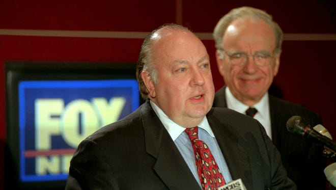 In this Jan. 30, 1996 file photo, Roger Ailes, left, speaks at a news conference as Rupert Murdoch looks on.