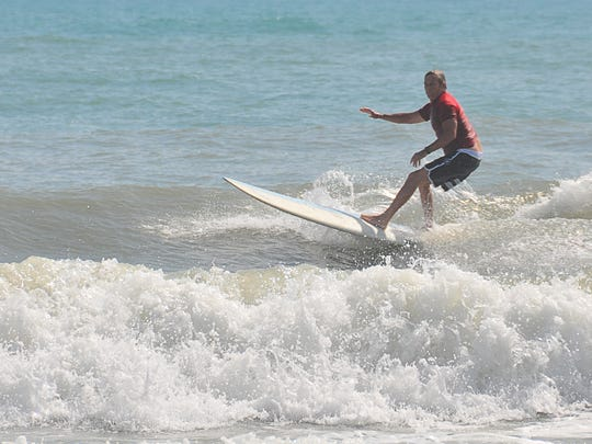 Bob Freeman competes in the Legends longboard event at the 52nd annual Cocoa Beach Easter Surfing Festival, an event he won a dozen times.