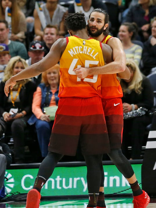 Utah Jazz guards Ricky Rubio, right, and Donovan Mitchell (45) celebrate late in the second half of the team's NBA basketball game against the Los Angeles Lakers on Tuesday, April 3, 2018, in Salt Lake City. (AP Photo/Rick Bowmer)