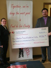 Salvation Army Capt. Telinda Wilson stands with Thrivent