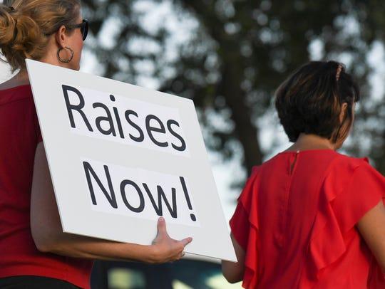 Teachers picket in front of School Board headquarters