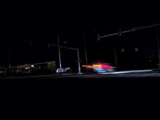 A motorists drives through a blacked out intersection at Carlisle Street and Clearview during a major power outage in Hanover this week. More than 5,000 were without power for more than 2 hours.