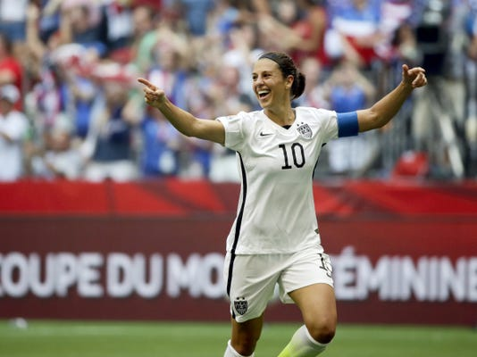 American Carli Lloyd celebrates after scoring her third goal against Japan during the first half of the FIFA Women's World Cup soccer championship in Vancouver, British Columbia, Canada, on Sunday. The Americans won, 5-2.