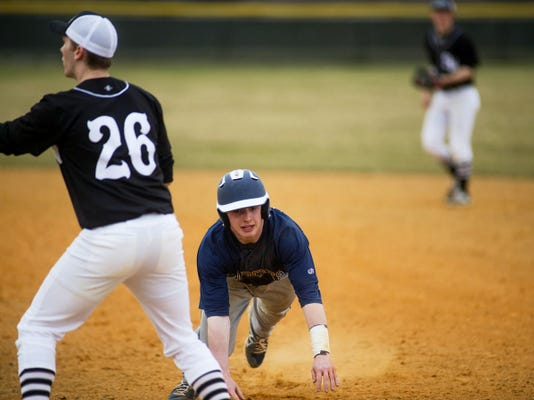 Dallastown's Jake Garrity dives back to first base as South Western's Austin Weaver reaches for a throw at South Western High School. South Western won, 13-6.