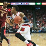 """Louisville's Trey Lewis had 16 points and three assists with two steals in the Cards 79-47 win Saturday. Mitchell finished with 10 points. """"We have some classy fans,"""" said Lewis after the show of support Saturday. """"They're hurting. Every game is going to be emotional now."""" Feb. 6, 2016"""