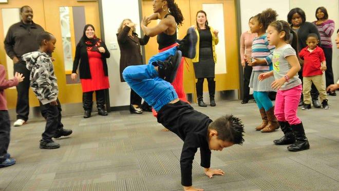 Aydan Martinez dances at an event featuring preschoolers and their parents at Casa Azafran last week.