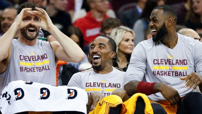 LeBron James, J.R. Smith and Kevin Love crack up on bench during win.