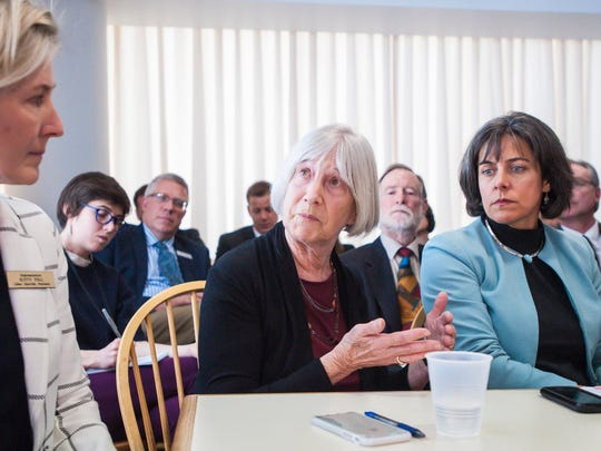 Rep. Janet Ancel, D-Calais, chairwoman of the House Ways and Means Committee, center, joins other democratic legislative leaders to react to Gov. Phil Scott's budget address to the Legislature at the Statehouse in Montpelier on Tuesday, January 23, 2018. Looking on are Rep. Kitty Toll, D-Danville, chairwoman of the House Appropriations Committee, left, and Speaker of the House Mitzi Johnson, D-South Hero.