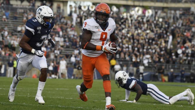 Illinois wide receiver Josh Imatorbhebhe (9) runs in for a touchdown during the second half of a game against Connecticut on Saturday, Sept. 7 in East Hartford, Conn.