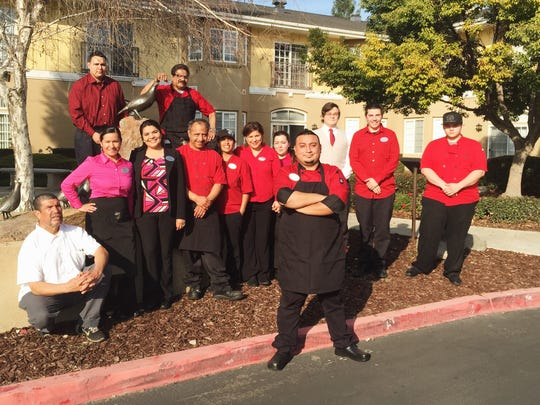 """Chef Albert Hernandez from """"The Untamed Chef"""" poses with his staff at  Quail Park Retirement Village where he now serves as as the executive chef."""