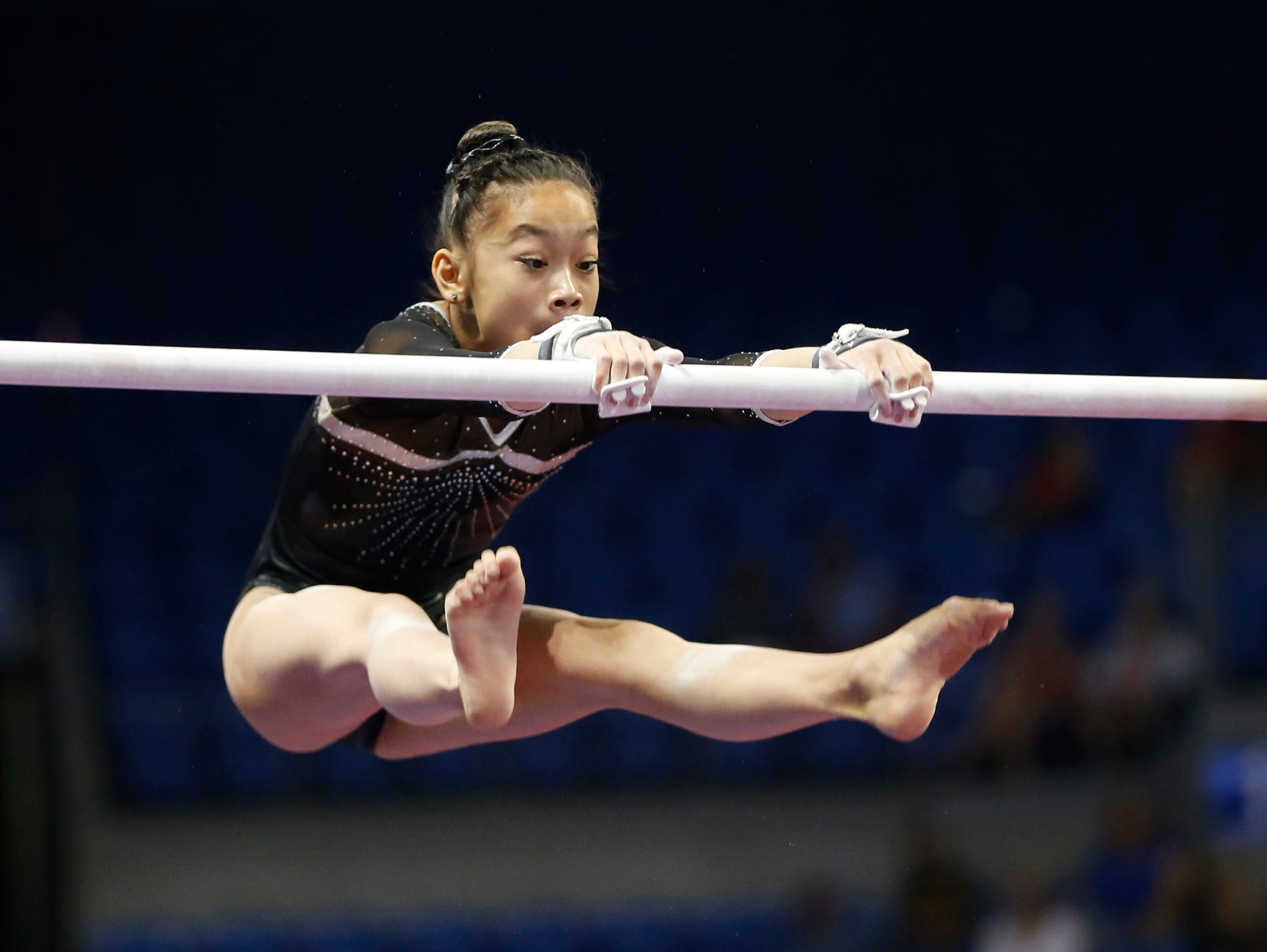Iowa City's Adeline Kenlin competes in the uneven bars Sunday, June 26, 2016, during the second day of the junior women's event at the P&G Gymnastics Championships at Chaifetz Arena in St. Louis.