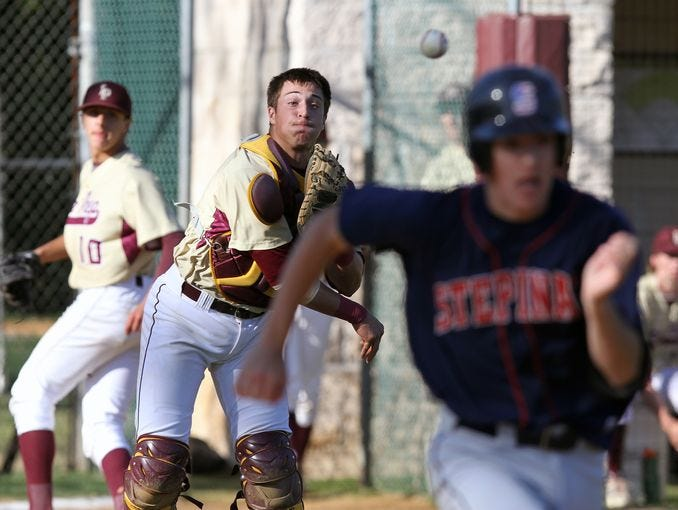 Chris Dutra makes a throw in Iona Prep's 15-6 win over Stepinac in a baseball game at Iona Prep in New Rochelle April 28, 2015.