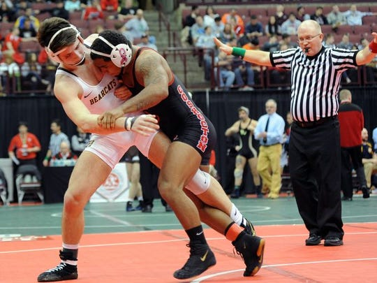 Paint Valley's Caleb Johnson (left) wrestles Coshocton's