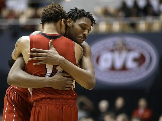 Austin Peay guard Khalil Davis (11) and Chris Horton hope to help the Governors pull off an upset in the first round of the NCAA Tournament against No. 1 seed Kansas.