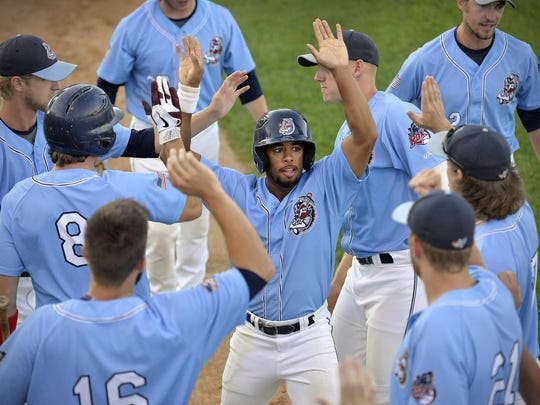 St. Cloud Rox player Marcus Carson (5) celebrates a run against the Rochester Honkers in the fourth inning of their Northwoods League playoff game Monday night at Joe Faber Field in St. Cloud. The Rox won 4-0.