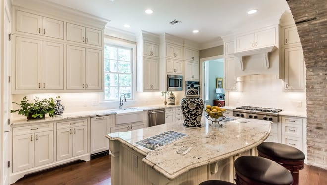 The kitchen at 604 Oak Hill Drive features a large island.