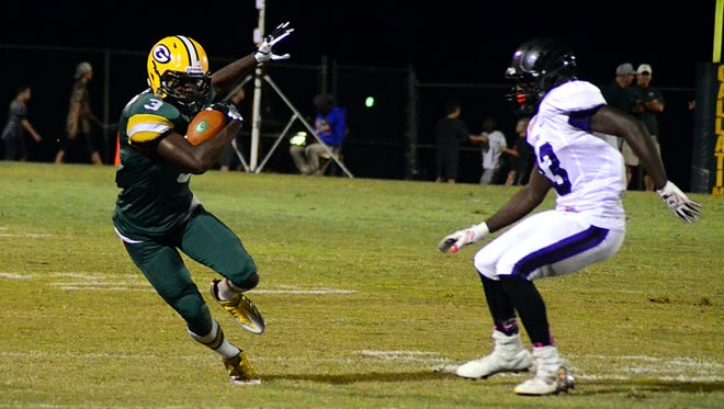 Gallatin High senior Marcus DeVault cuts away from a Cane Ridge defender during first-quarter action.