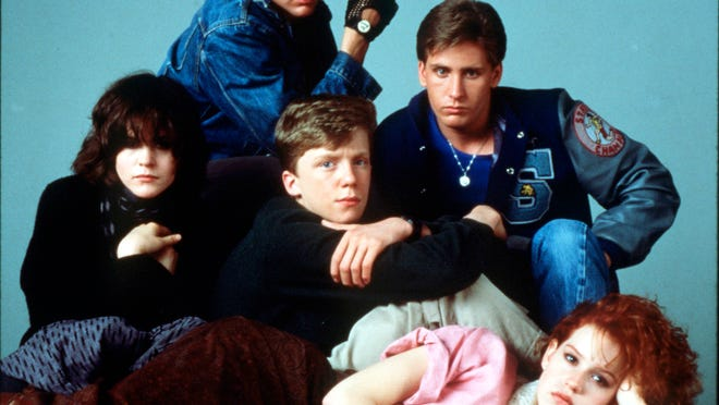 "Molly Ringwald, lying down, Ally Sheedy, second row, left to right, Anthony Michael Hall, and Emilio Estevez, Judd Nelson, third row from the motion picture""Breakfast Club."" (Gannett News Service, Universal City Studios)"
