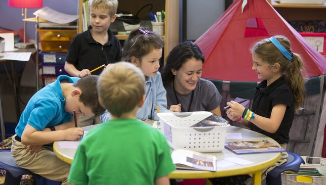 Students work with a teacher at IPS #84, Indianapolis, Wednesday, May 18, 2016. Ethnically, the Center for Inquiry School 84 is one of the least diverse in the IPS system, and enrollment priority is given to kids living near its Meridian-Kessler location.