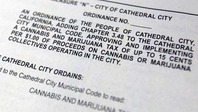 Measure N appears in a voter information pamphlet for Cathedral City on Tuesday, November 4, 2014. Measure N proposes a tax on marijuana of up to fifteen cents per dollar.