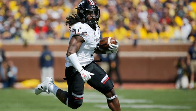 Cincinnati Bearcats running back Mike Boone (5) runs to the outside in the first quarter of the NCAA football game between the Michigan Wolverines and the Cincinnati Bearcats at Michigan Stadium in Ann Arbor, Mich., on Saturday, Sept. 9, 2017. At the half, the Wolverines led 17-7.
