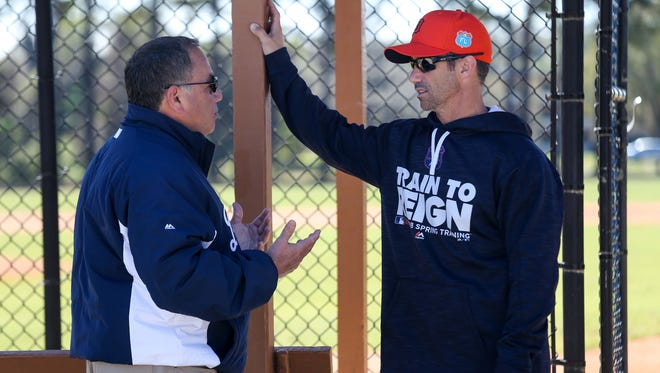 Tigers Executive Vice President of Baseball Operations & General Manager Mike Avila talks with Manager Brad Ausmus, during Detroit Tigers last practice of spring training at Joker Marchant Stadium in Lakeland, Fla. on Sunday, Feb. 28, 2016.