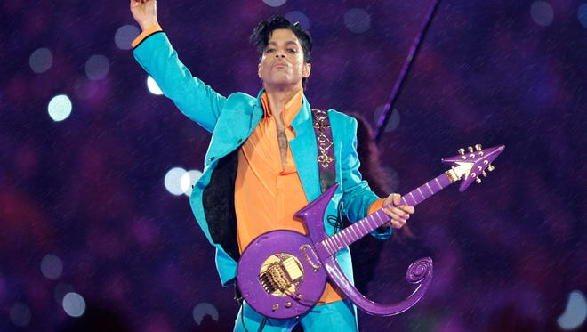 In this Feb. 4, 2007 file photo, Prince performs during the halftime show at the Super Bowl XLI football game at Dolphin Stadium in Miami. The disclosure that some pills found at Prince's Paisley Park home and studio were counterfeit and contained the powerful synthetic opioid fentanyl strongly suggests they came to the superstar illegally. Prince died April 21, 2016, of an accidental fentanyl overdose.