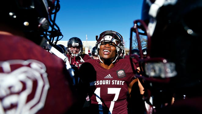 Missouri State Bears wide receiver Malik Earl (17) talks to his teammates in a huddle prior to the start of the game against the Youngstown State Penguins on Nov. 19, 2016.  Earl, a senior, was selected to theMissouri Valley Football Conference 2017 Preseason First Team after catching 41 passes for 534 yards and 3 touchdowns last season.
