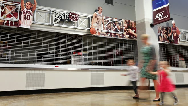 Patrons walk by a closed concession stand prior to one of the Fall commencement ceremonies at JQH Arena on Dec. 16, 2016. The stands will start selling some alcoholic beverages during sports events as part of a pilot program by Missouri State University.