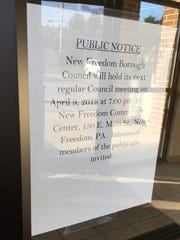A notice posted outside the New Freedom Borough building, stating that the next borough council meeting will be held at the community center. Christopher Dornblaser photo.