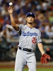 Starting pitcher Yu Darvish (21) throws to first base for an out during game against the New York Mets at Citi Field on Friday, Aug. 4, 2017. It was Darvish's first game with the Los Angeles Dodgers.