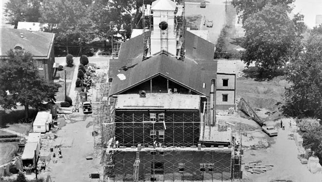 Construction underway after Paine's fire of 1968.