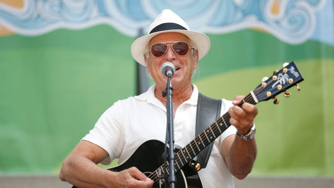 Jimmy Buffet sings on the steps of the old Capitol building on Tuesday. The performance was part of the Everglades Action Day rally at the Capitol, sponsored by the Everglades Coalition.