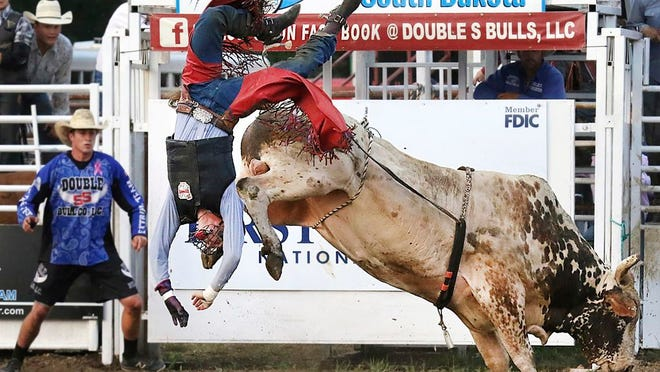 From Aug. 18, 2018, Jordan Allen of Buffalo, Mo., is thrown from this bull during competition at the Extreme Bull Riding Tour stop in Yankton, S.D. Professional Bull Riders has announced a new series of competition that will culminate in South Dakota on July 10-12 with live crowds. Event organizers said they will provide face coverings to fans, space seats four to six feet apart and control the flow of people in and out of the arena to accommodate social distancing.