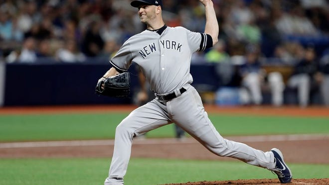 New York Yankees pitcher J.A. Happ delivers to a Tampa Bay Rays batter during the third inning of a baseball game Wednesday, Sept. 25, 2019, in St. Petersburg, Fla.