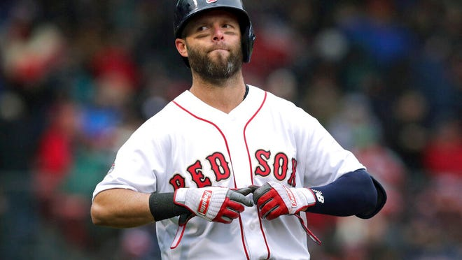 """FILE - In this Tuesday, April 9, 2019 file photo, Boston Red Sox's Dustin Pedroia takes off his gloves after lining out to right field to end the sixth inning of the home opener baseball game against the Toronto Blue Jays in Boston. Red Sox second baseman Dustin Pedroia had what the team called a """"significant setback"""" while rehabbing his left knee, the latest blow to the four-time All-Star's attempt to return to the field. Boston spokesman Kevin Gregg confirmed the development Tuesday, Jan. 21, 2020."""