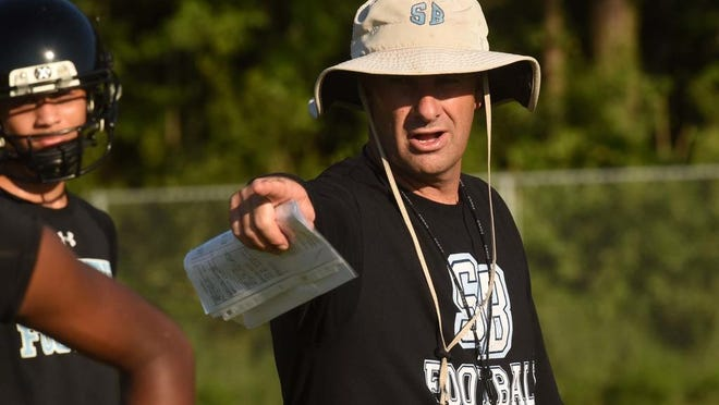 South Brunswick football coach Rocky Lewis during the first day of practice on Monday, July 31, 2017.