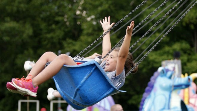 Delilah Hannahs, then 8, of Reynoldsburg enjoys an amusement ride during last year's Reynoldsburg Tomato Festival at Huber Park. This year's festival has been canceled because of the COVID-19 coronavirus pandemic.