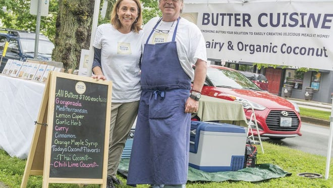 Published Caption:              Lori and Brian Halloran of Jamestown launched their flavored butters at farmer's markets. They are at the Wednesday afternoon Aquidneck Growers' Market on Memorial Boulevard in Newport. PHOTO BY DAVE HANSEN
