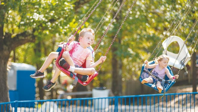 Children from across the lake enjoy the swing ride at the 2019 Hillbilly Fair, one of many rides and attractions open for families to enjoy.